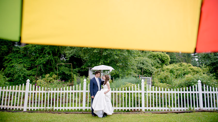 colorful rainy wedding day portraits with umbrellas