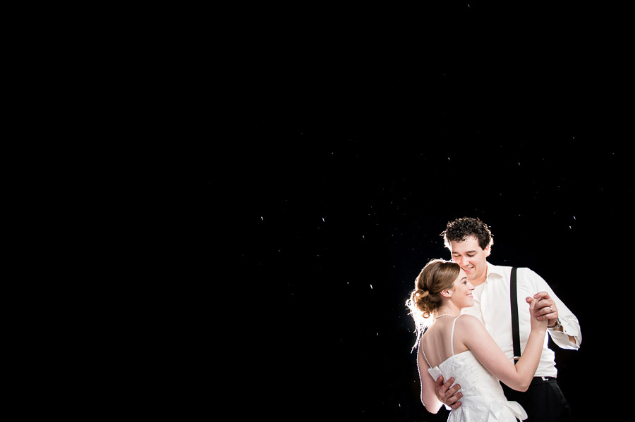 Super hip strobist wedding moment at night in the rain
