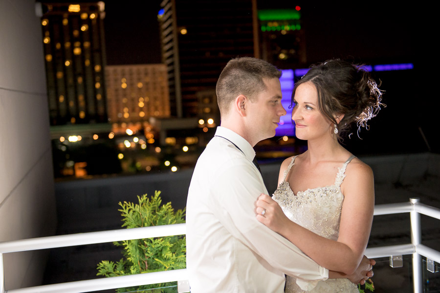 Nighttime wedding portrait on Ali Center balcony in Louisville