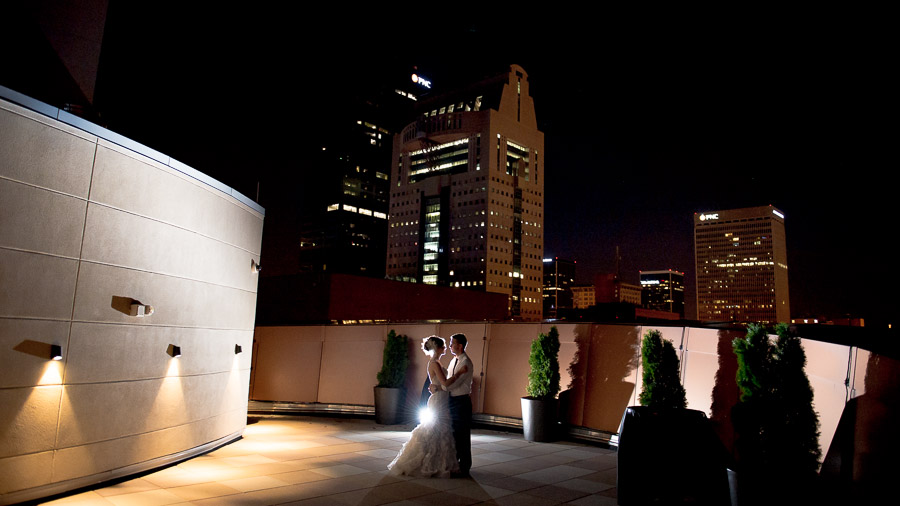 balcony wedding portrait with louisville cityscape