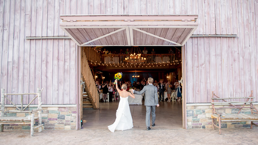 fun and dramatic bride and groom entrance into ceremony at County Line Orchard wedding