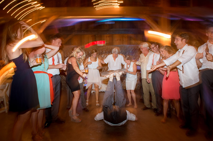 Funny wedding dance floor photo of dude doing the worm