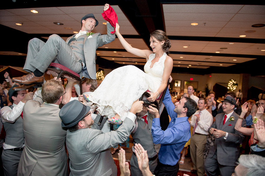 awesome and fun bride and groom photo at wedding reception during the hora