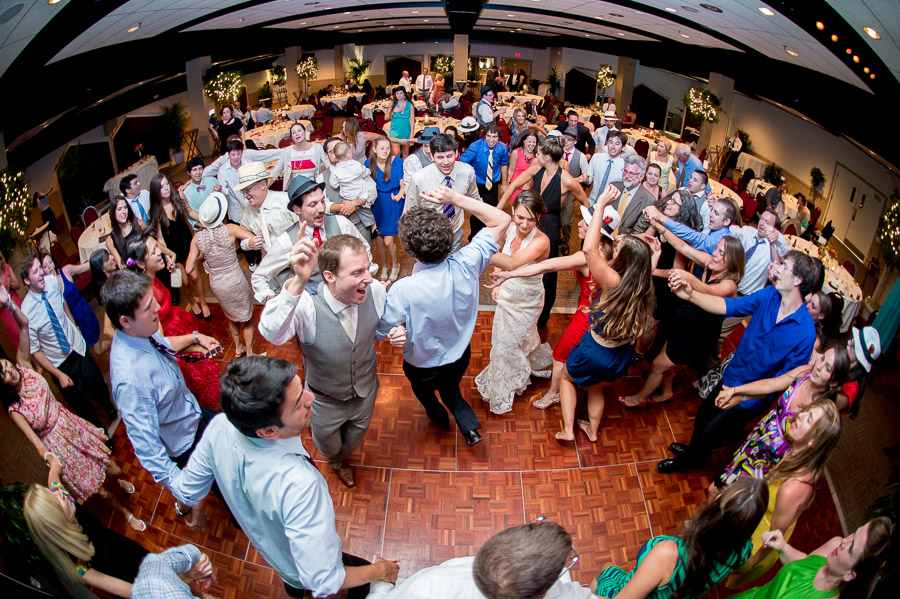 wild, fun, crowded dance floor at wedding reception in Virginia