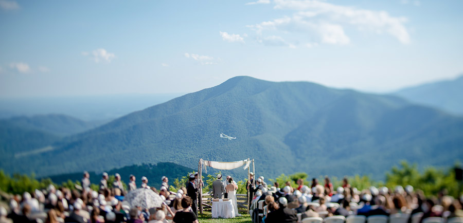 amazing wedding moment at wintergreen overlook with glider flying through mountains