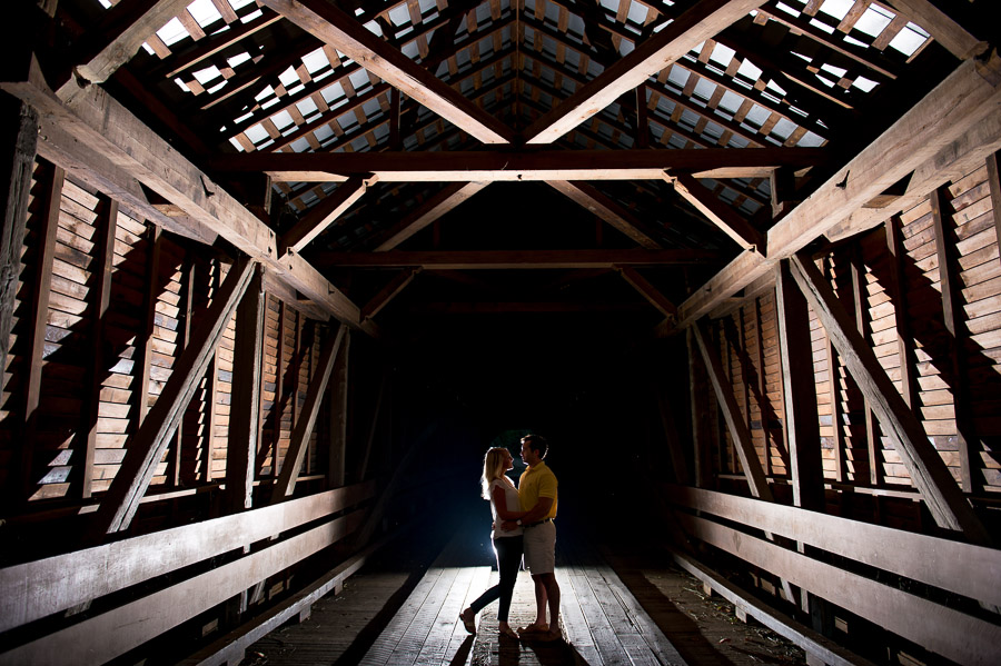 Dramatic, edgy, unique engagement photo at Meem's Bottom covered bridge in New Market Virginia