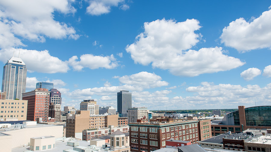Sunny, Indianapolis cityscape at downtown wedding in Indiana