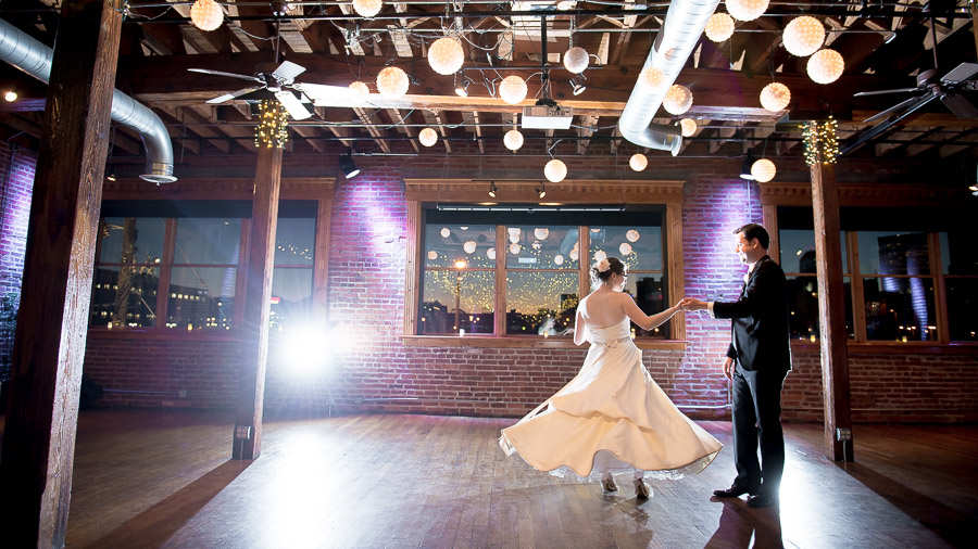 Fun first dance photo with twirling dress at Mavris Art Center wedding in Indiana