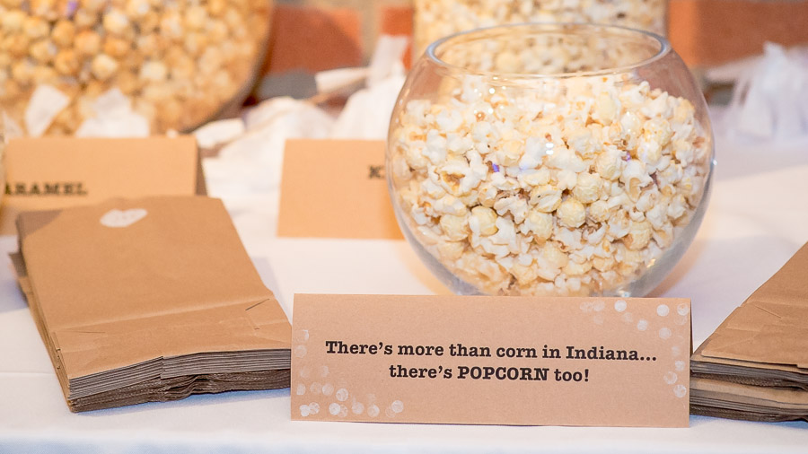 Funny, creative flavored popcorn table at Indiana wedding