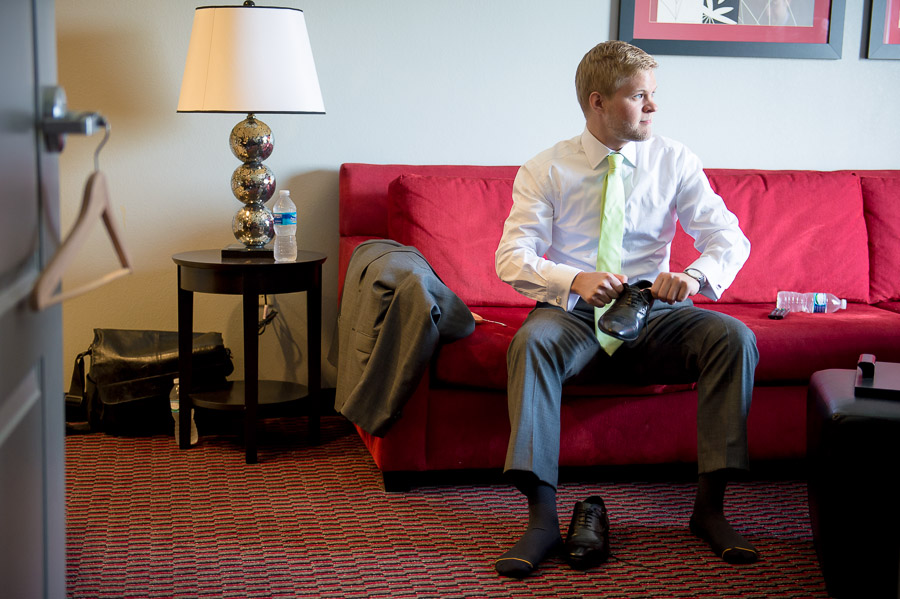 colorful, fun photo of groom getting ready for Virginia wedding