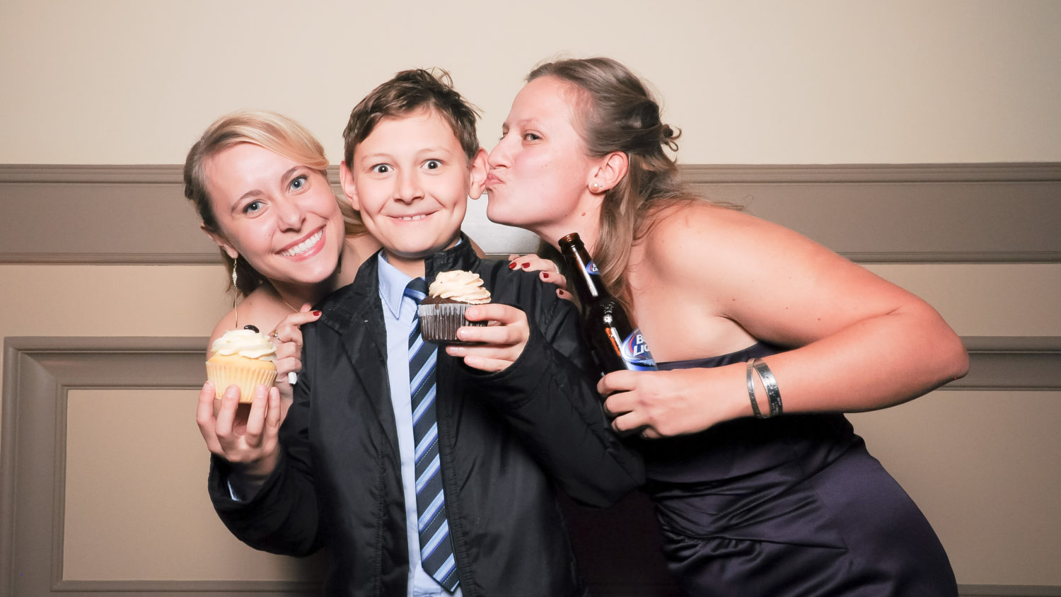funny kid in wedding photo booth