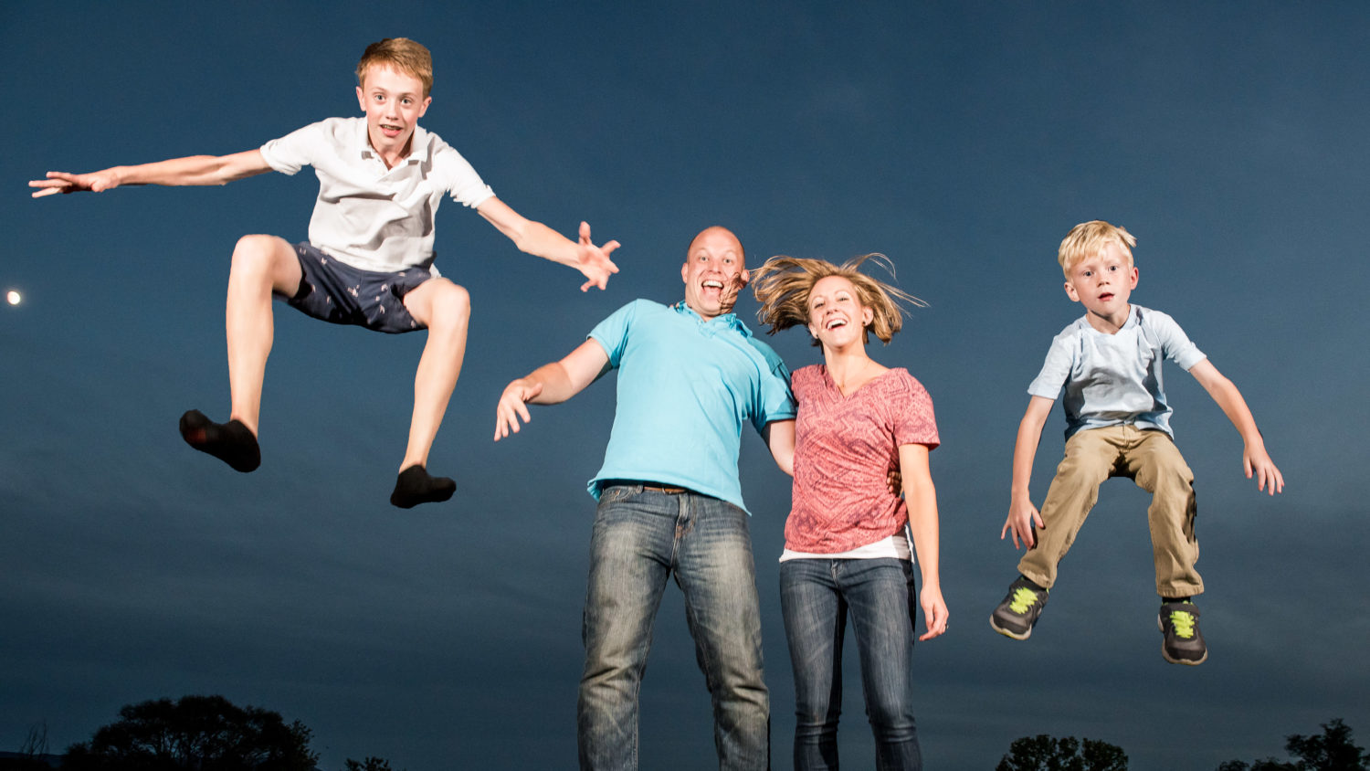Fun family photos on trampoline