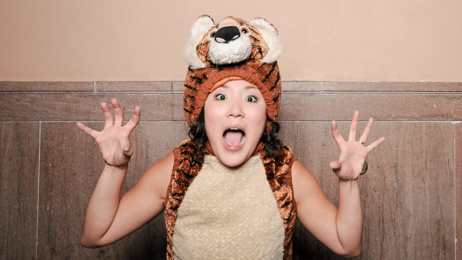funny tiger costume in wedding photo booth
