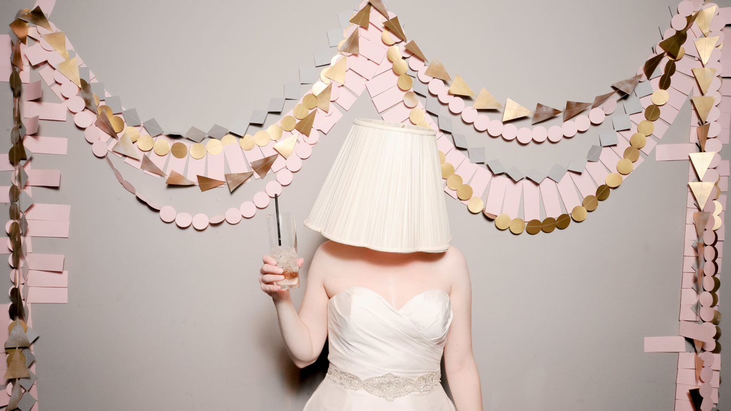 lampshade on head in funny wedding photo booth
