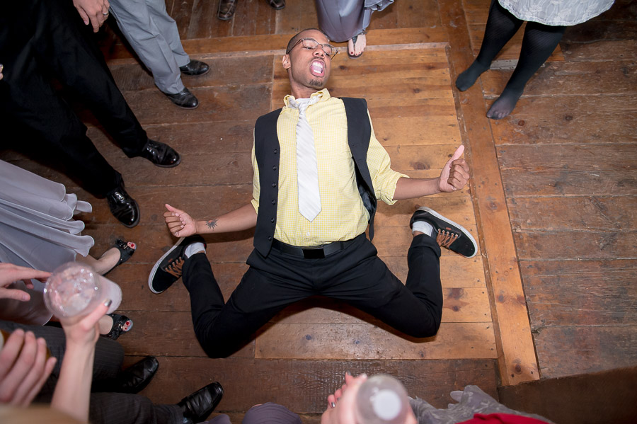 awesome photo of wedding guest break dancing on dance floor at Noblesville, Indiana wedding