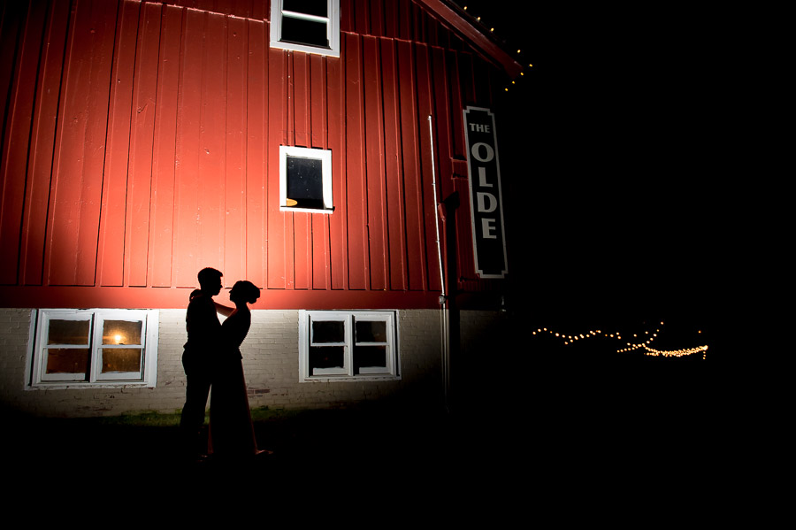dramatic, creative and quirky image of bride and groom at Indiana barn wedding