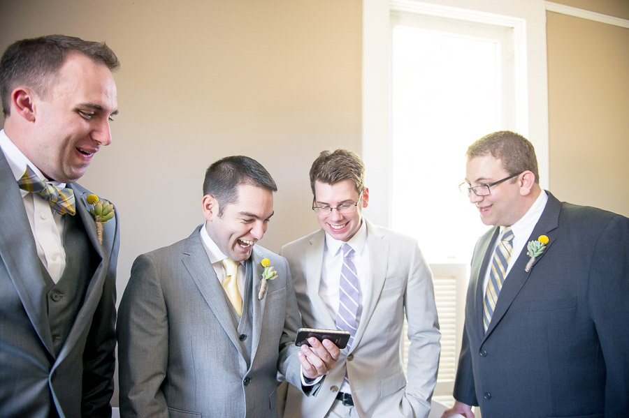 Groomsmen and groom laughing and having fun before wedding ceremony in Noblesville Indiana
