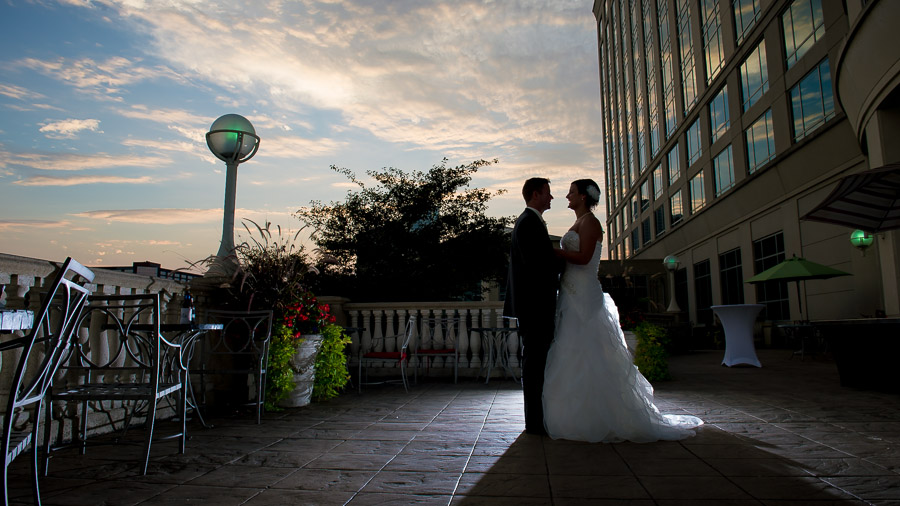 beautiful sunset photo of bride and groom on terrace at Indiana wedding