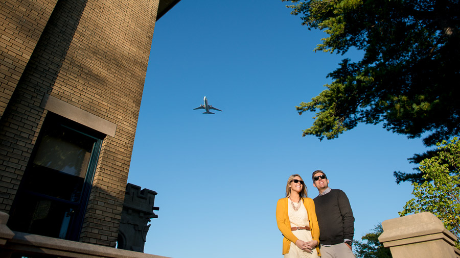 super fun engagement photo with airplane overhead in downtown Indianapolis, Indiana