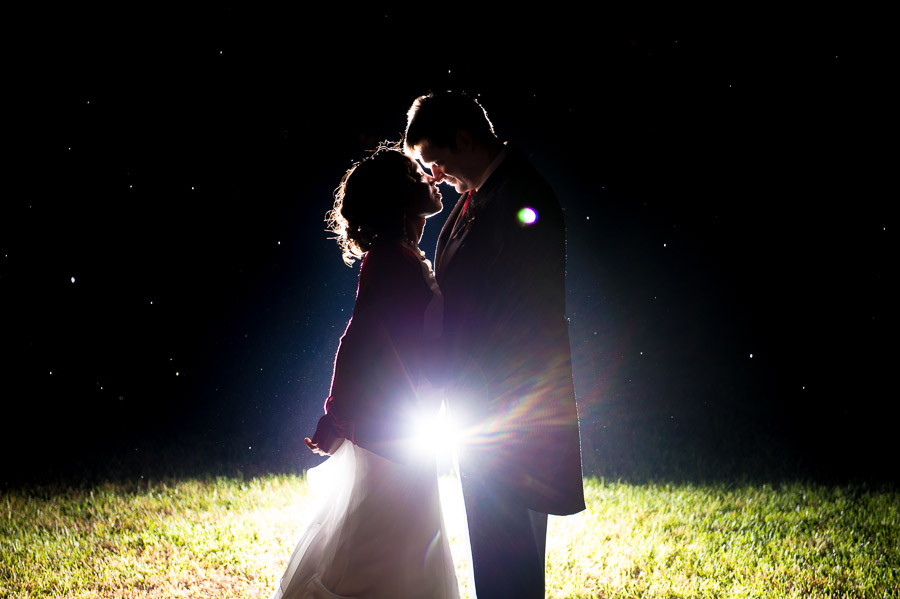 Awesome nighttime rainy wedding portrait by TALL+small.