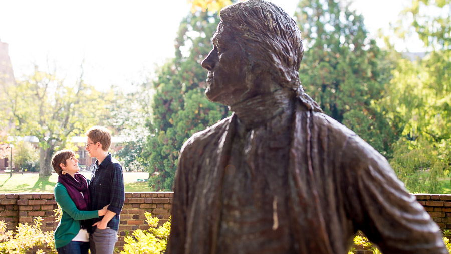 Silly and quirky engagement photo with Thomas Jefferson statue on William and Mary campus
