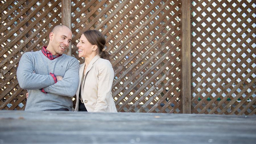 Happy, sweet, engaged couple in downtown Bloomington, Indiana
