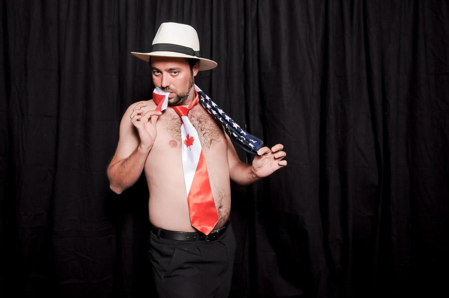 Very funny photobooth photo of shirtless guy with Canadian tie at Virginia wedding