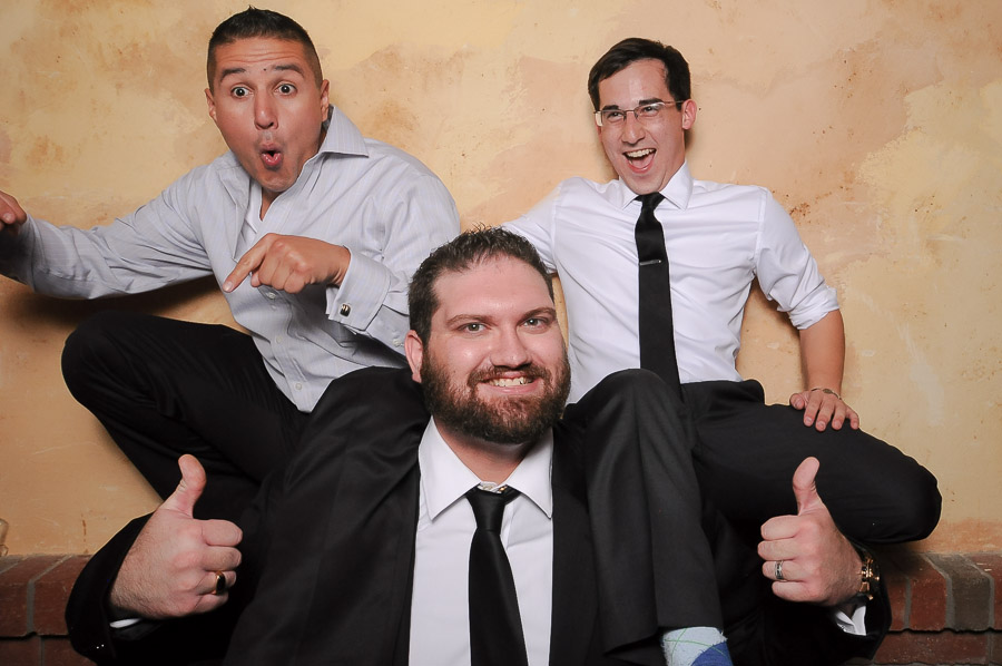Strongman lifting two guys in photobooth photo at Bloomington, Indiana wedding
