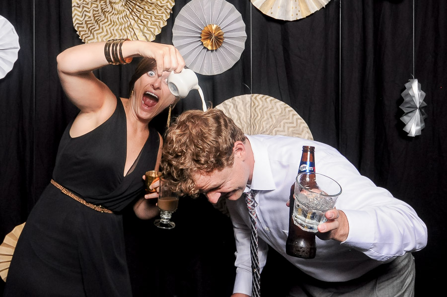 Hilarious, silly, wacky photobooth photo of dude getting creamer poured on his head at Louisville, KY wedding