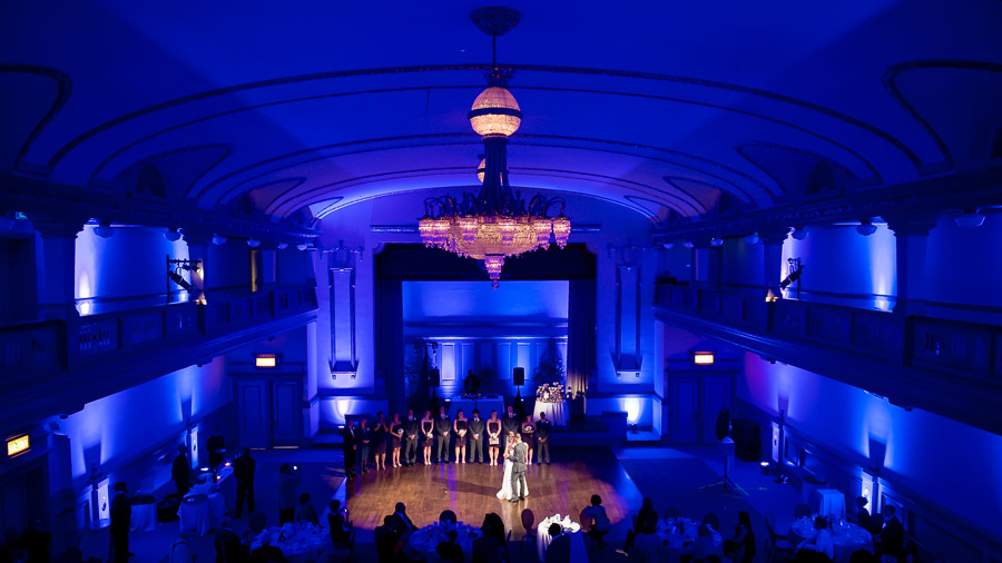 Gorgeous, dramatic, first dance photo with blue lighting.