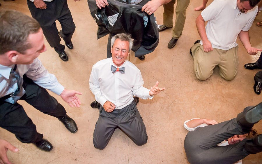 Epic father of the bride air guitar-ing at Northern Indiana wedding