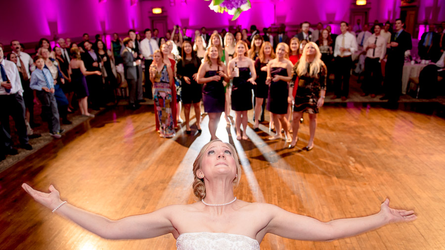 Perfectly timed bouquet toss by TALL + small Photography!
