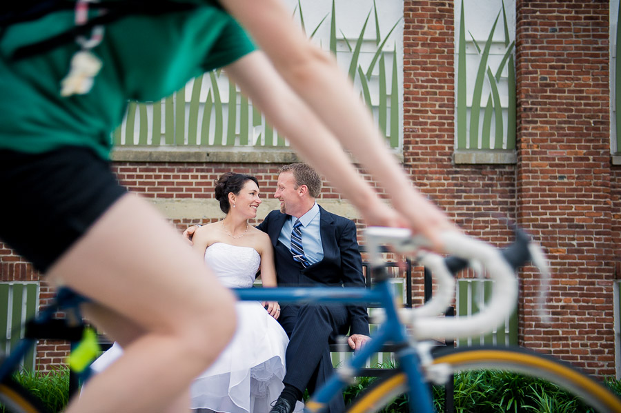Fun, quirky bride and groom portrait with biker going by on the B-line in Bloomington!