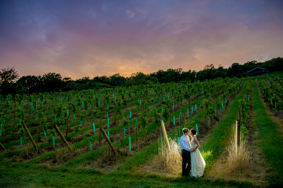 Colorful, beautiful sunset at Leesburg, VA winery wedding by TALL + small Photography