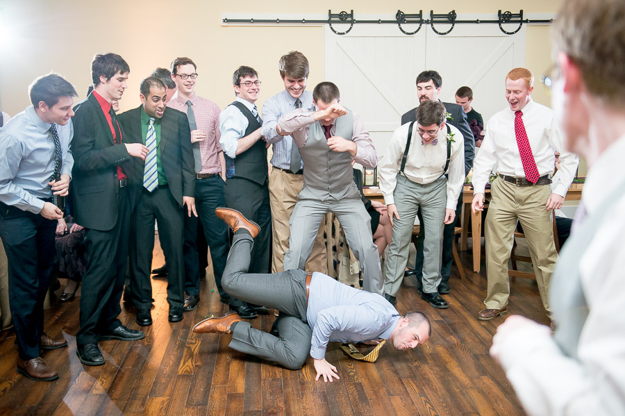 Hilarious moment of dude diving for garter at King Family Vineyard winter wedding