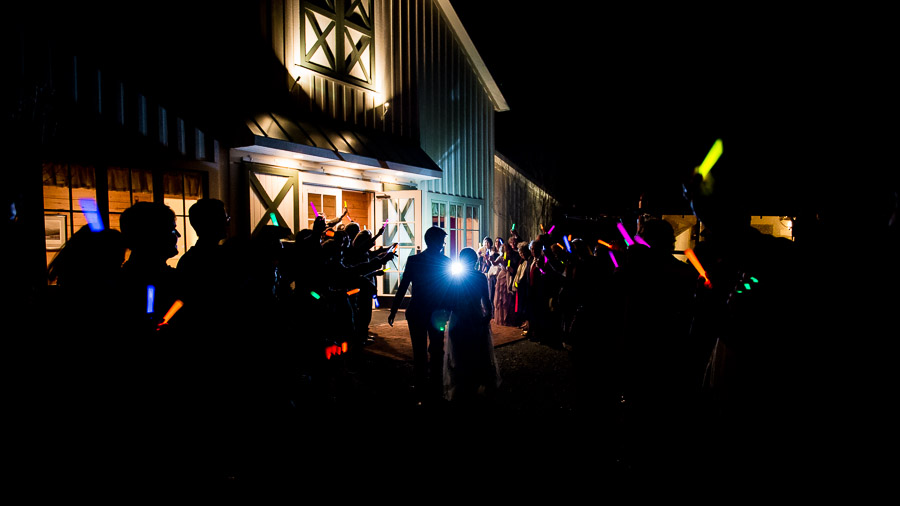 Fun, nighttime wedding exit with glow sticks at King Family Vineyard winter wedding