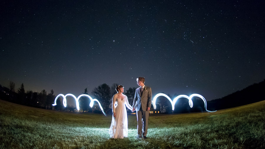Dramatic, starry night, light painting portrait of bride and groom at King Family Vineyard winter wedding