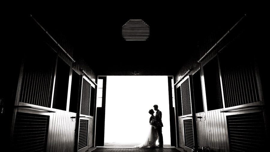 Beautiful black and white barn silhouette with bride and groom at King Family Vineyard