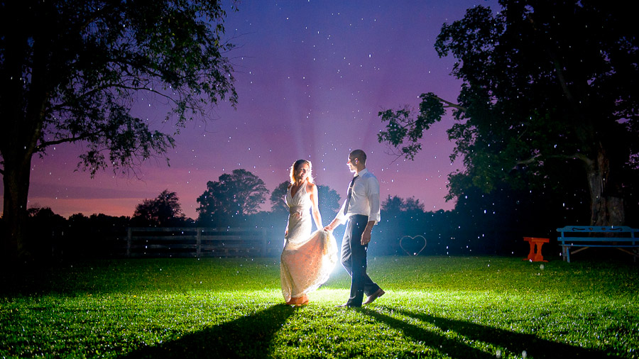 Breathtaking, colorful, nighttime wedding portrait at Sycamore Farm in Bloomington by TALL+small Photography.