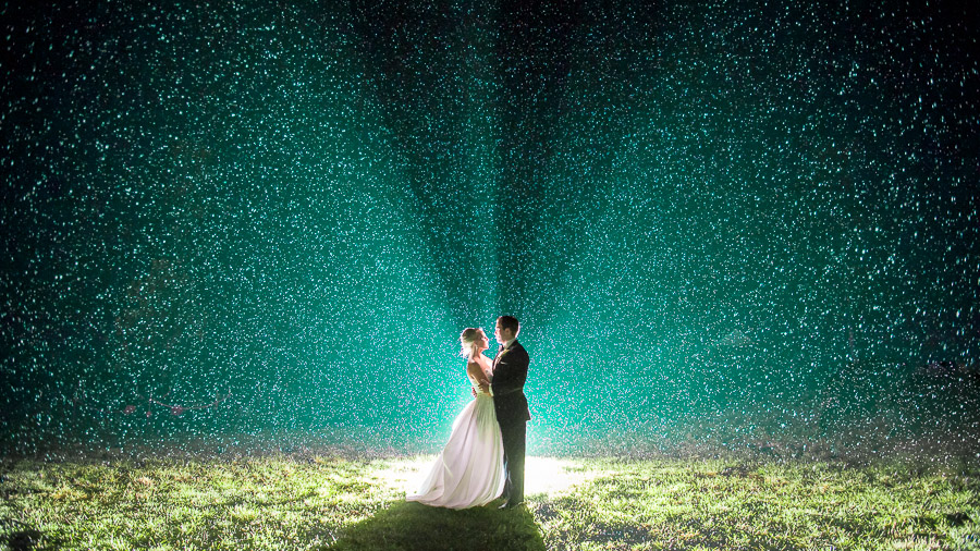 Stunning backlit rainy nighttime wedding portrait at Virginia wedding by Tall and Small Photography