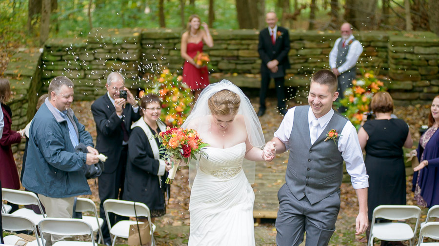 Bride and groom exit with rice toss at outdoor, Fall, state park wedding