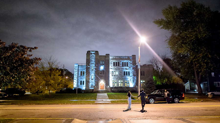 Sweet bride and groom exit at Butler University wedding
