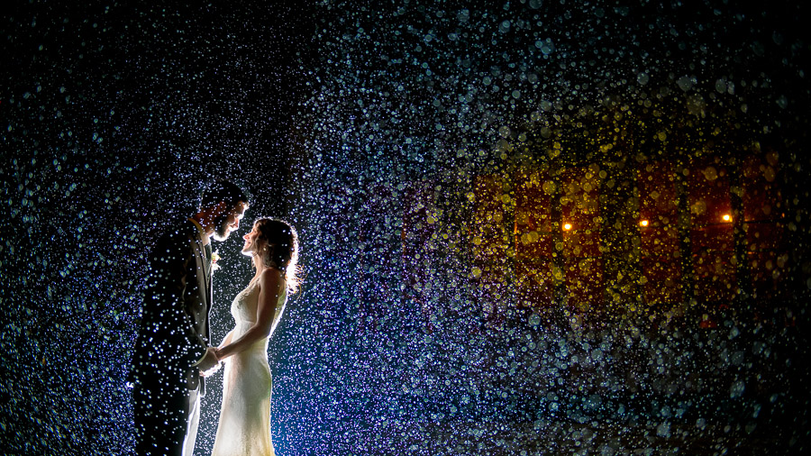 Gorgeous, dramatic, rainy wedding day photo in Indianapolis, Indiana