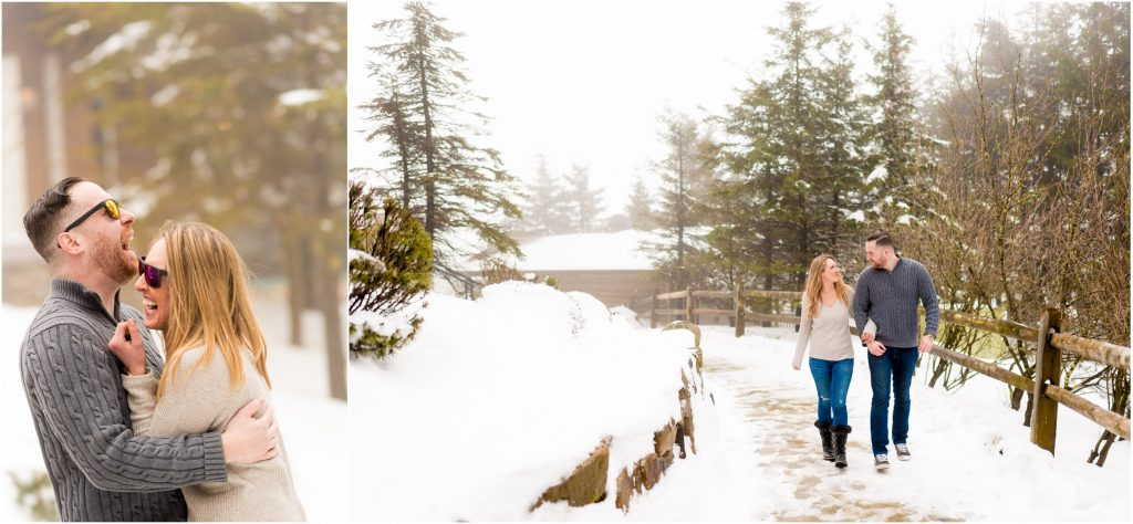 Couple walking and cuddling in the snow at their engagement shoot.
