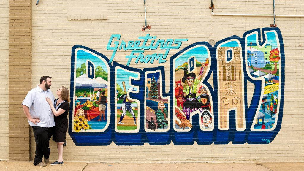 Sarah + Travis at one of the many cool Del Rey murals during their Alexandria engagement photos