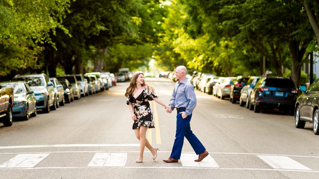 Becky and Rob crossing the street in the Fan for their Richmond engagement pics
